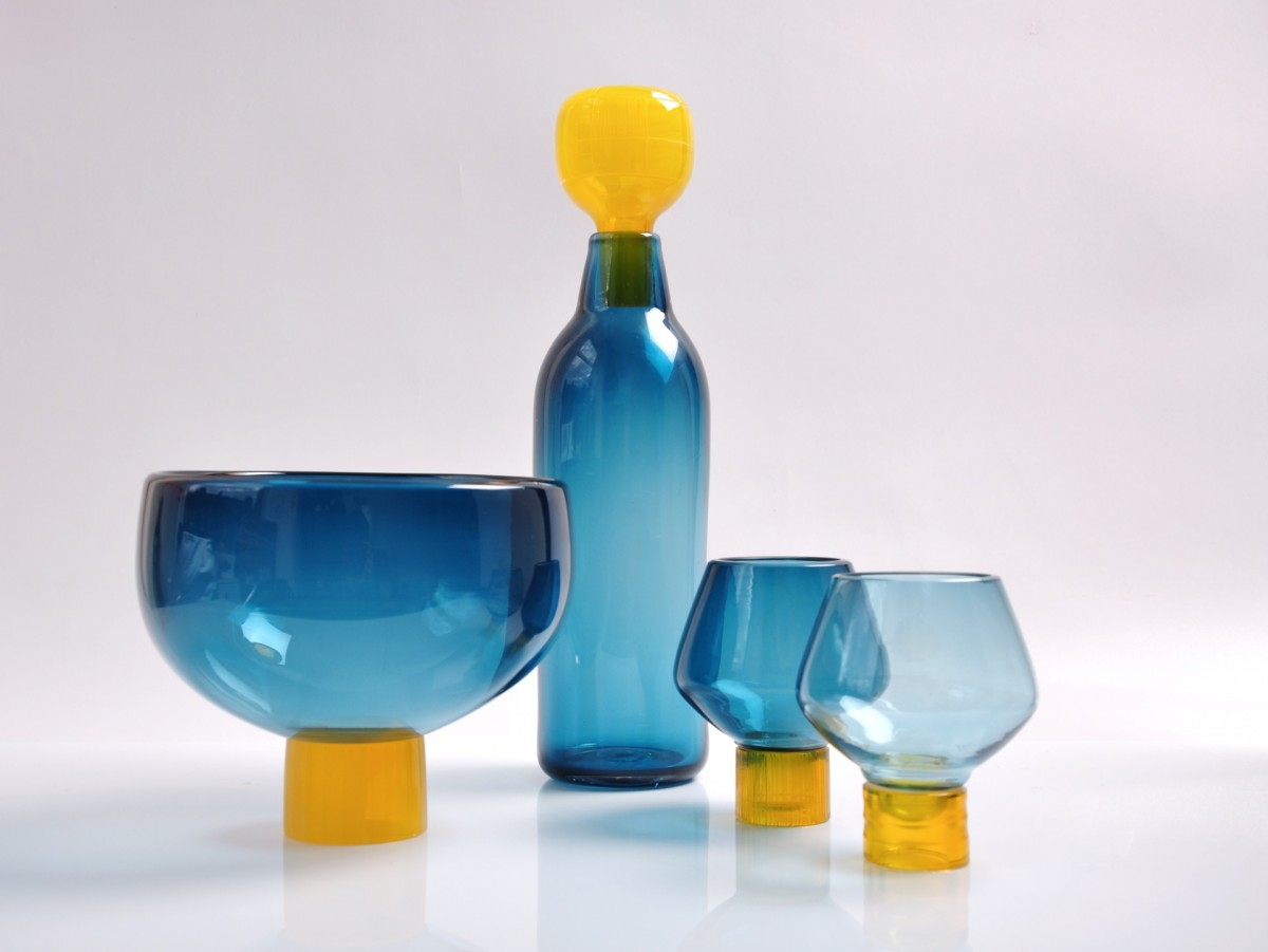 Blue glass bottle, bowl and glasses with yellow details