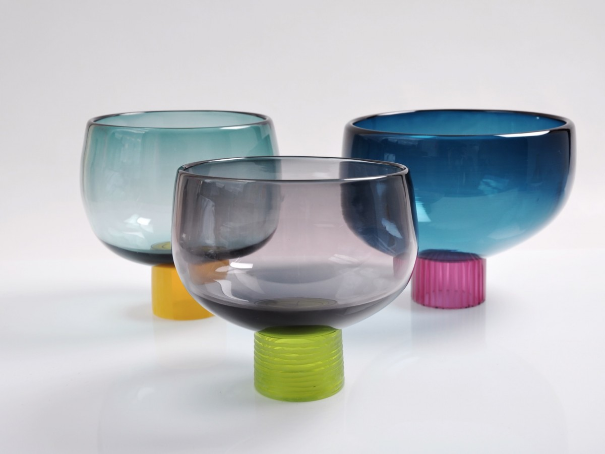 Three glass bowls with multi-coloured feet