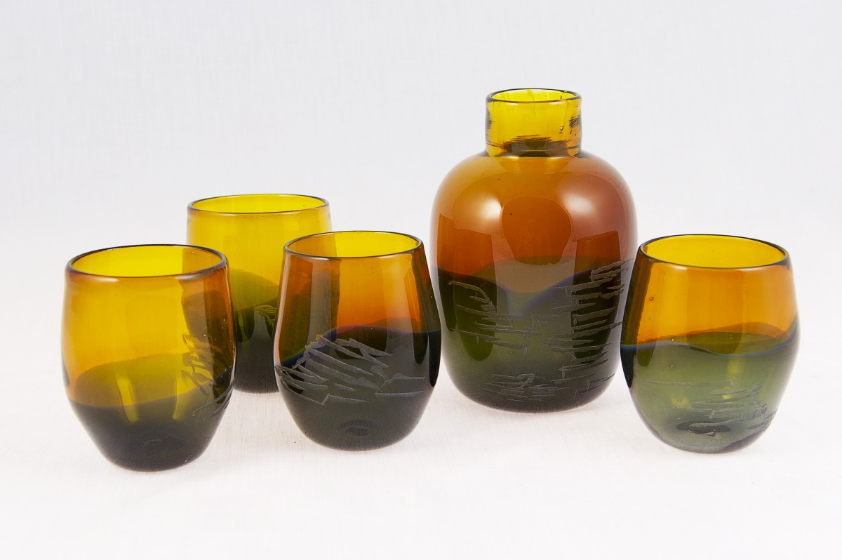 Amber and brown glass flask and four glasses with rock pattern engraving