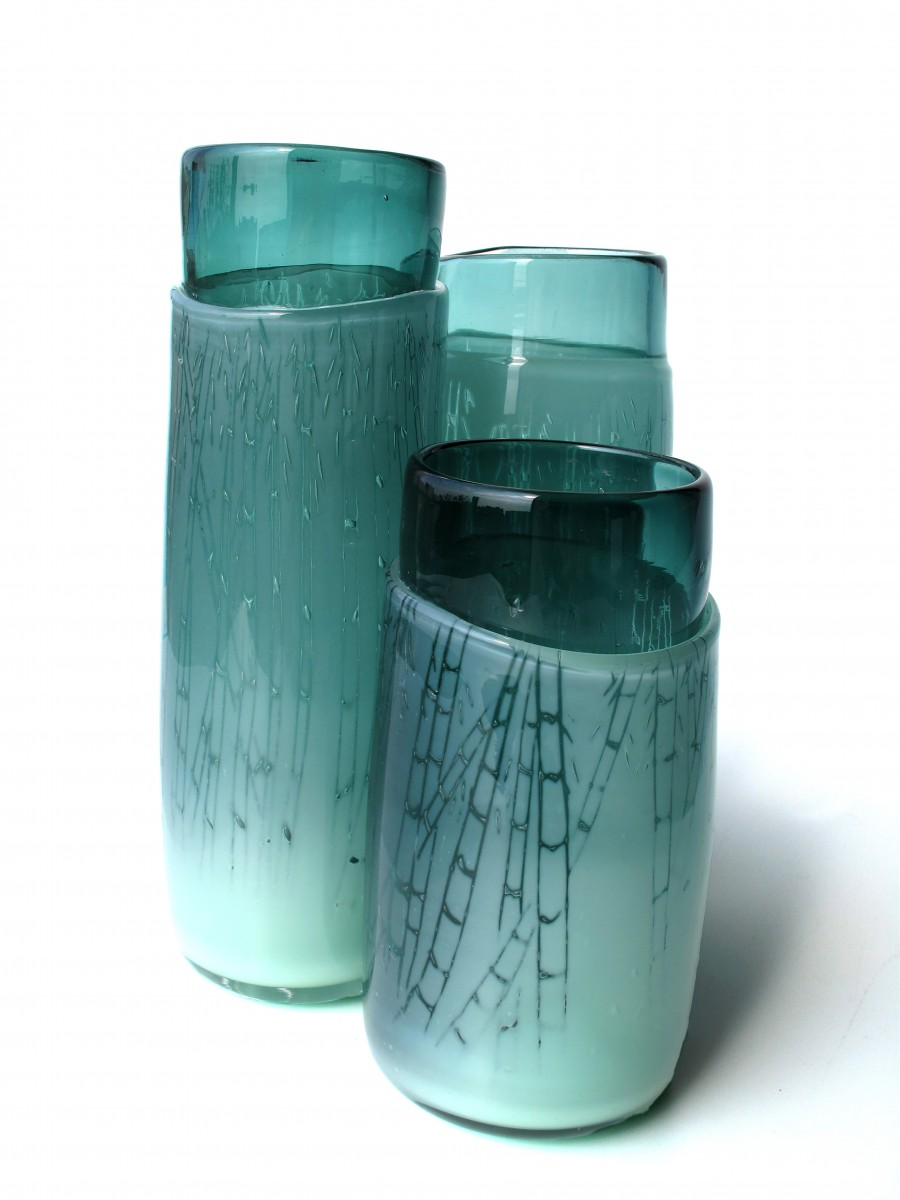 Three green glass vases with engraved bamboo patterns