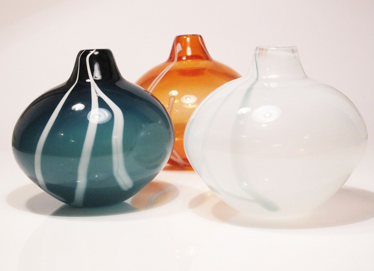 Three glass vases in sea green, apricot and white with stripe decoration